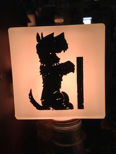 This was a small bedside lamp with a single bulb covered by a cube of glass with the Scottie printed on it.