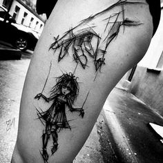 Meaningful tattoo idea in sketch style. A puppet controlled by a hand piece is inked on the girl's thigh. This tattoo means struggle and desire to be free.