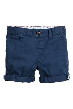 Shorts in soft washed cotton twill with an adjustable elasticated waist, zip fly and button. Side pockets and a fake welt pocket at the back.
