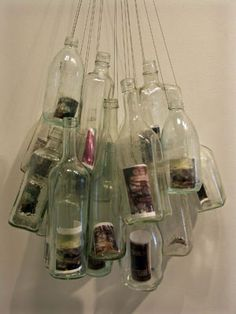 Clear Glass Bottles + hanging wire + photos = Awesome Hanging Photo Display