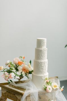 "From the editorial ""A Wedding Editorial Inspired by Art Nouveau Era Perfume Ads."" If this four-tier wedding cake gives you major ethereal vibes... just wait until you see the rest of the photoshoot! Photographer: @laceandluce #weddingcake #etherealwedding #4tiercake #romanticweddingcake #whitecake #cakeinspo"