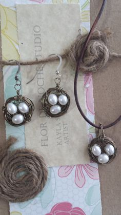 Bird's nest earrings and necklace set featuring clusters of fresh water pearls & Artwire, finished with sterling earwires and leather cord.