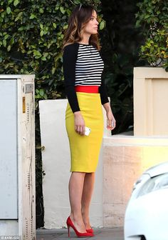 Oliva Wilde on set - love how the pencil skirt colour really pops.
