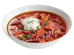 Beef Borscht (No. 42) : Sweat 1/2 head chopped cabbage and 2 each chopped celery stalks, leeks, carrots and parsnips in oil. Add thyme, 1 tablespoon tomato paste, a bay leaf and 10 cups beef broth; simmer 30 minutes. Add 4 diced roasted beets and 2 cups shredded cooked beef; simmer 15 minutes. Top with sour cream and dill.