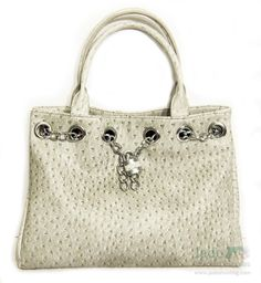 Urban Moxy Nicole  A beautiful and iconic design with stunning chain accents featuring an exterior locking concealed pocket with hanging charm chain. $97.99