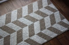 DIY Painted Herringbone Rug - white paint on a cheap grey rug... could use the one I have now...