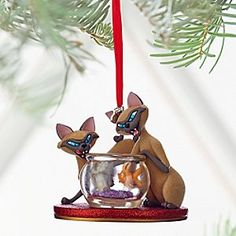 Si & Am Sketchbook Ornament - Lady and the Tramp - Personalizable | Disney Store Keep an eye on our Siamese cats, if you please. This sparkling Si & Am ornament will make mischief all through the holiday season. The goldfish bowl is bound to be rocked whenever these flocked felines are on the prowl.