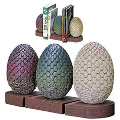 It's The Bookends - Game Of Thrones - Dragon Egg Bookends. Daenerys Targaryen is given three petrified dragon eggs as a gift for her wedding to Khal Drogo. Dark
