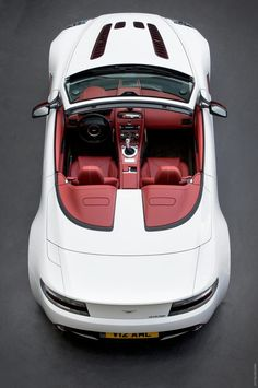2013 Aston Martin V12 Vantage Roadster. love the red leather on white exterior.