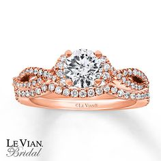 Vanilla Diamonds® swirl around a central diamond and across the engagement ring and wedding band of this stunning bridal set from Le Vian Bridal®. Crafted in luscious 14K Strawberry Gold®, the beautiful set has a total diamond weight of 1 1/3 carats. Le Vian®. Discover the Legend. Diamond Total Carat Weight may range from 1.29 - 1.36 carats.