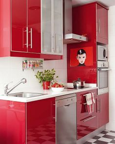 This is a snazzy and compact red and white kitchen!