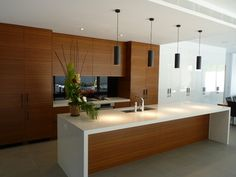 Great teak cabinets and lighter countertop