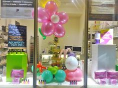 beauty salon window display ideas - balloon flowers with a chalk board to display prices and that you need a nail tech