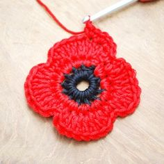 Crochet Flowers Ideas 1 - Get those hooks out. here's a free Remembrance Poppy Crochet Pattern. Crochet Butterfly Free Pattern, Crochet Coaster Pattern, Crochet Puff Flower, Crochet Flower Tutorial, Crochet Flower Patterns, Crochet Ideas, Knitted Poppies, Knitted Flowers, Crochet Crafts