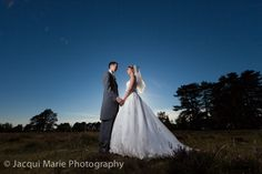 Bride and groom against a blue evening sky in the New Forest, photographed by Hampshire wedding photographers Jacqui Marie Photography. VISIT http://jacqui-marie-photography.co.uk for details.  #wedding #photography #weddingphotography #Hampshire #England #uk