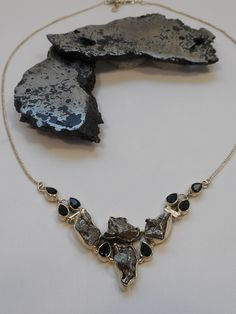 Handmade Meteorite gemstone necklace adorned with 4 organic-shaped Campo del Cielo Meteorite stones and 8 vibrant faceted Onyx gemstones, bezel-set in beautifully hinged 925-hallmarked sterling silver