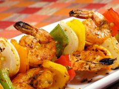 Skewers of shrimps with vegetables Ingredients:  tiger shrimps - 200 g sweet pepper - 75 g onions - 75 g tomatoes cherry 75 g fresh basil - 15 grams lemon - 2-3 slices lettuce leaves - 2-3 pcs soy sauce - 1 tbsp black olives - 5 pcs italian herbs -1/4 tsp  Preparation: 1. Shrimp cleaned from the shell, put on the grill, drizzle with oil, season with Italian herbs and bake until done. If you can not cook the shrimp on the grill, you can fry in a pan. 2. Onions and bulgarian pepper of…