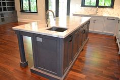 Perfect 10 Design Custom Kitchen island with seating. Black Berenson Hardware…