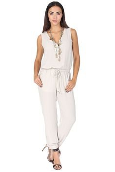 Beige chiffon tank jumpsuit featuring  front button closure, drawstring waistband and dual side pockets. This classic jumpsuit is a must-have! Pair with some cute flats for running around or dress it up with a printed heel. So easy to wear!