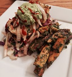 Salmon cakes with grilled mushrooms, onions, avo and turkey bacon. Over homemade coleslaw with non dairy pesto sweet potato fingerlings