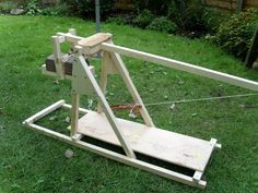 Atomic Shrimp's Two Hour Trebuchet was designed and constructed in a mere 2-hours (hence the name). Amazingly enough, there were no blueprints used for the build, which uses 1-ich batten for the frame and throwing arm. A heavy engineering brick strapped to a wooden skid serves as the counter weight, which is used to fire tennis balls as projectiles. (Link)