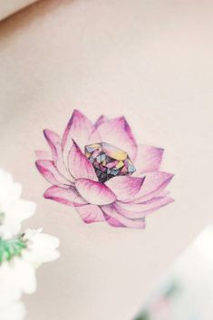 LOTUS FLOWER TATTOO IDEAS Various religions and cultures appearance the lotus tattoo differently. Thus, in Buddhism, the lotus is the analogue of Hand Tattoo, Wrist Tattoos, Flower Tattoos, Body Art Tattoos, New Tattoos, Lotus Tattoo Foot, Blue Lotus Tattoo, Unique Tattoos, Beautiful Tattoos