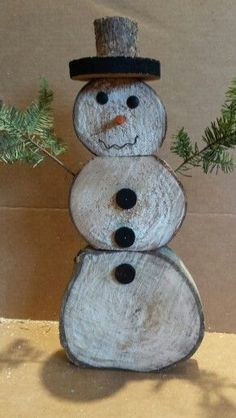 DIY Rustic Christmas Decorations snowman-out-of-logs-and-pine-boughs-easy-and-fun-to-make Christmas Wood Crafts, Country Christmas, Outdoor Christmas, Homemade Christmas, Christmas Art, Christmas Projects, All Things Christmas, Winter Christmas, Holiday Crafts