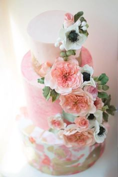 Featured Cake: Cake by Annie; Creative pink wedding cake covered in anemones and pink garden roses