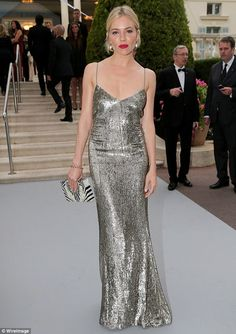 All that glitters... Thhe star captured attention in acustom-made silver slinky Ralph Lau...