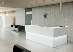 Ice white corner reception desk with under counter accent lighting. #office #receptiondesk #officedesign