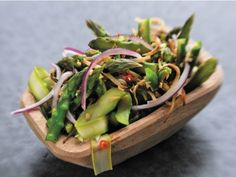Asparagus Kerabu from Zak Pelaccio's Eat with Your Hands via Serious Eats - charred and raw asparagus with lime juice and Asian fish sauce.