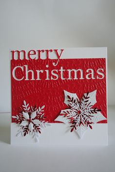 Memory Box Grand Merry Christmas,Spellbinders Poinsettia, Penny Black snowflake,Embossalicious Merry Christmas Folder.