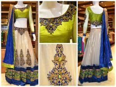 Enhance your elegance with this neon green choli with off-white lehenga & royal blue border and matching dupatta.