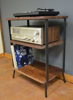 1 walnut and steel shelving unit for LP player, power and Vinyl. Dims:  top: 26x17x33 middle: 23x16x22 lower: 23x16x7  For shipping purposes some assembly required. You will need a screw driver. I will send screws and mark all holes. Sturdy  Custom sizing available  shipping via FED EX Ground