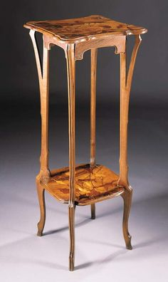 A FRUITWOOD MARQUETRY STAND BY EMILE GALLE - the square top with inlaid decoration of a butterfly amongst foliage, on shaped legs united by an undertier with similar decoration, with inlaid maker's singature, worm holes overall.