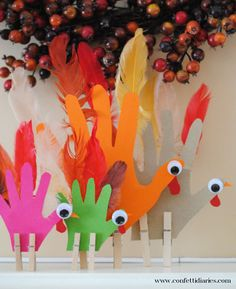 Colorful Handprint Turkeys Thanksgiving Craft to make as a family
