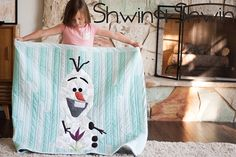 A free Olaf quilt pattern. Inspired by the lovable snowman from Disney's Frozen.