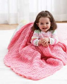 A simple lacy stitch adds texture to this fun and easy baby blanket. Stripe yarns using the pattern for a fun ripple effect. Shown in Bernat Baby Coordinates.