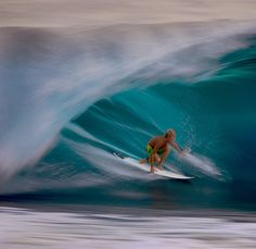 ddb44844293ee A speed blur of a surfer riding a wave on the North Shore of Hawaii at the  Banzai Pipeline. Panning with the surfer creates the look of fluidness of  the ...