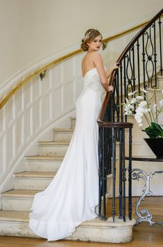 Nia - this beautiful sheath wedding dress has modern cutaways, sparkling embellised waist detail, a stunning button back and is in a gorgeous crepe fabric. Available to try at Honeyblossom Bridal boutique in Sale, Cheshire xx Wedding Dress Styles, Designer Wedding Dresses, Crepe Fabric, Lace Bodice, Crepe Dress, Beaded Lace, Bridal Boutique, Bridal Collection, Bridal Style