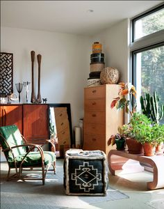 Home of Zoe Bissell and Bryan Buryk.  The house is in the Catskills and was built from a kit called the LVL Home, designed by architect Rocio Romero.  One of the things I love best about this home is the beautiful interior light from the windows.  I just love small smart spaces, don't you?