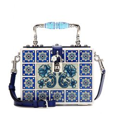 Dolce & Gabbana - Dolce wooden shoulder bag - Dolce & Gabbana present yet another conversation piece. The latest 'Dolce' bag is as sculptural as ever, a masterpiece of one of the house's recurring themes - Mediterranean majolica ceramics. The divine box is ornately painted in the Spanish tile pattern with a silver-tone handle and pretty shoulder strap in a textured cerulean blue. seen @ www.mytheresa.com