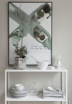Gray-green and white and beige. Sideboard styling.