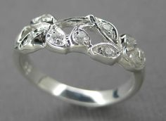 Engagement ring or anniversary ring.14k white gold leaf ring with diamonds.. $595.00, via Etsy.
