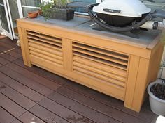 air conditioner cover and counter! make from salvaged materials from a place like Build It Green, e., old shutters and countertops? Ac Unit Cover, Ac Cover, Air Conditioner Screen, Pool Shed, Outdoor Kitchen Countertops, Old Shutters, Outdoor Kitchen Design, Outdoor Kitchens, Backyard Retreat