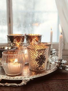 Cluster your silver and glass votives on a gleaming tray—this is one time when more is more—and set it by your windows to cast a magical glow at night.