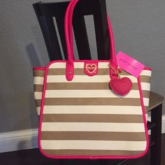 Betsey Johnson bag Big beautiful new Betsey Johnson tote bag, winged spice stripe with pink trim!  Free sparkly puffy heart charm!   Gold hardware, magnetic snap closure.  Zip pockets and two open pockets inside.  New with tag attached. Betsey Johnson Bags Totes