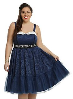 """Police Public Call Box Doctor Who. The fit and flare dress has a fitted bodice with a white and black embroidered fold-over sweetheart neckline and adjustable straps, with contrasting black piping princess seams that lead to the black fitted waistband featuring """"Police Public Call Box"""" text design. The flowy skirt has multiple layers including a tulle underlay to give your silhouette some volume and a tulle ruffle at..."""