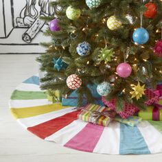 We have a bright colored tree skirt. Felt polka dots of varying sizes and colors on a light turquoise background. Sparkly balls in turqoise, green, silver, and red...need pink.
