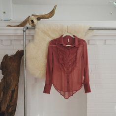 FREE PEOPLE/ ruffle blouse ⱝ dark blush, raspberry color ⱝ tuxedo style blouse ⱝ sheer, ruffled material ⱝ free people  ⱝ best fits a small ⱝ perfect condition ⱝ extra long length   » I NO LONGER LOWER MY PRICES, BUT OFFERS ARE ABSOLUTELY WELCOMED  » UNLESS ITS FOR A BUNDLE, I WILL NOT RESPOND TO OFFERS IN COMMENTS   » I WILL MAKE A NEW LISTING FOR DISCOUNTED SHIPPING Free People Tops